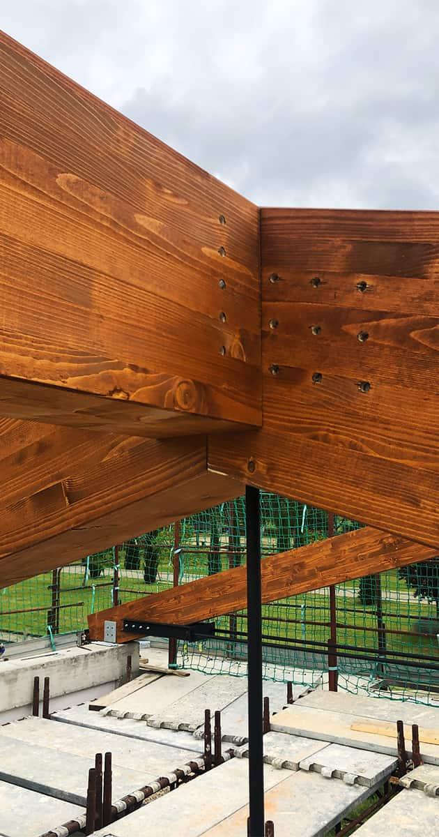 particolare connessione travature legno lamellare